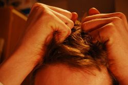 Photo of stressed out person pulling hair