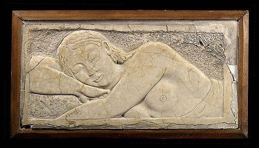 Carving of sleeping man